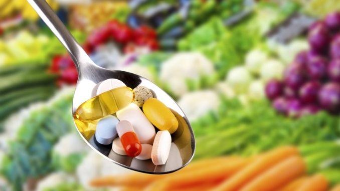 spoon-pills-dietary-supplement