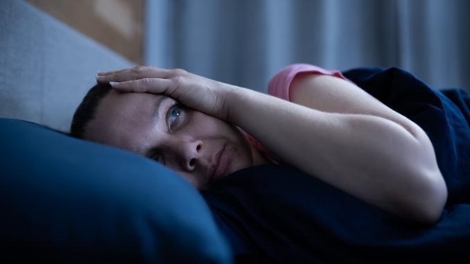 insomnia-bed-awake-woman