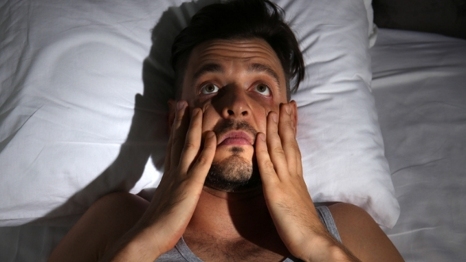 man-suffering-insomnia-bed